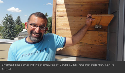 Shafraaz Kaba sharing the signatures of David Suzuki and his daughter, Sarika Suzuki